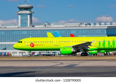 Moscow / Russia - 10.04.2018. Domodedovo International Airport. Passenger terminal, Air Traffic Control Tower (ATC) and aircraft of S7 Airlines.