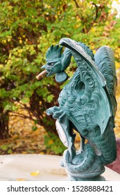 Moscow / Russia –October, 11, 2019: Basilisk at the fountain in the park named after Bauman, donated to Russia by the city of Basel.