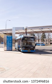 Moscow, Russia, 11 April, 2019:  Electric bus on the charging station at the time of recharging. Moscow, bus station at VDNH