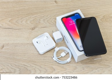MOSCOW, RUSSIA 12 NOVEMBER, 2017: Iphone X smart phone. Latest Apple Iphone 10 mobile phone. Illustrative editorial.  Unboxing newest Iphone with big touch screen and dual vertical camera