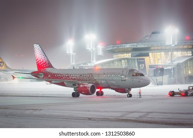Moscow / Russia - 12.26.2018. Vnukovo International Airport. Passenger aircraft Airbus A319 of Rossiya Airlines (Russia Airlines) taxiing on the airport taxiway during the snow storm.