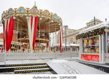 """Moscow, Russia, 12/28/2018, New Year. Christmas. Festive decoration of the city. Carousel at the subway station """"Ploshchad ' Revolyutsii"""". For the children's entertainment established a carousel."""
