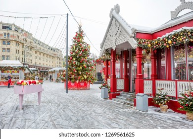 """Moscow, Russia, 12/28/2018, New Year. Christmas. Festive decoration of the city. Christmas tree and Chalet at the subway station """"Ploshchad ' Revolyutsii"""". Beautiful chalets adorn the city."""
