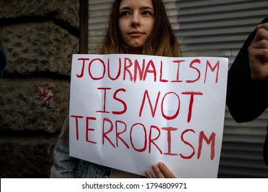 """Moscow, Russia. 12th of AUG, 2020 A woman holds a banner with the inscription """"Journalism is not terrorism"""" in support of independent journalists working in Belarus near the Belarus embassy in Moscow"""