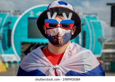 Moscow, Russia. 12th of June, 2021 A football fan wearing face mask visits the Fan Zone where will be streaming the UEFA Euro 2020 Group B match between Belgium and Russia, near Luzhniki Stadium