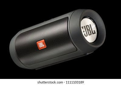 Moscow, Russia - 13 Jan 2018: JBL Charge 2 Plus Black bluetooth speaker (replica) on on black background. Illustrative editorial.