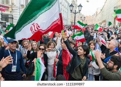 MOSCOW, RUSSIA - 13 JUNE, 2018: Wide angle picture of Iranian fans celebrating with flags in the streets of Moscow for the World Cup, Russia