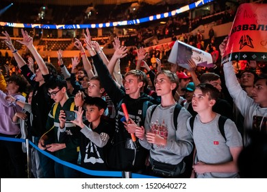 MOSCOW, RUSSIA - 14th SEPTEMBER 2019: esports event of a Counter Strike game. A lot of fans on a tribune at tournament's arena with hands raised. Cheering for their favorite team.