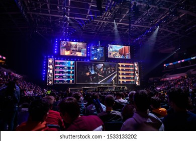 MOSCOW, RUSSIA - 14th SEPTEMBER 2019: esports Counter-Strike: Global Offensive event. Big illuminated main stage of a computer games tournament located on a big stadium. Tribunes are full of games