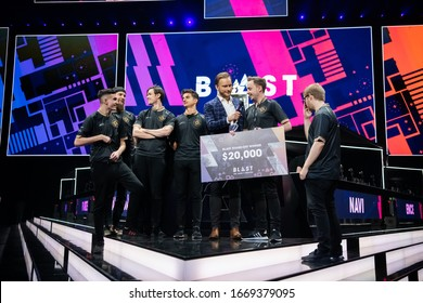 MOSCOW, RUSSIA - 14th SEPTEMBER 2019: esports event of a Counter Strike game. Winners of a standoff tournament team Ninjas in Pyjamas with a check in their hands with a prize money.