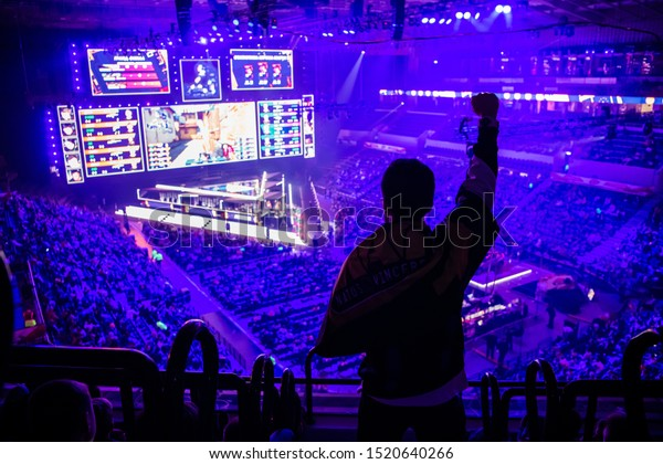 MOSCOW, RUSSIA - 14th SEPTEMBER 2019: esports Counter-Strike: Global Offensive event. Fan on a tribune at tournament's arena with hands raised.