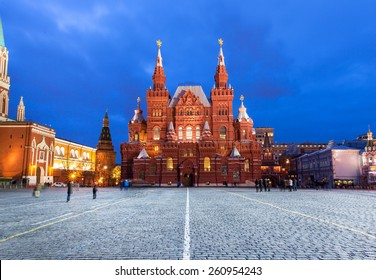 Moscow, Russia - 15 January, 2015: People walking and taking pictures in front of State Historical Museum building on the Red Square, Moscow at January 15, 2015.