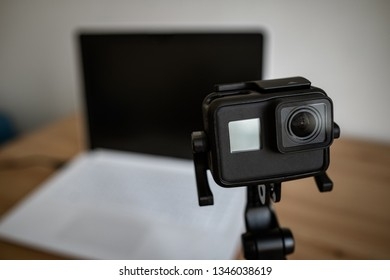 MOSCOW, RUSSIA - 17 MARCH 2019: Movement in front of the computer camera. Action Camera front-facing on the table. GoPro HERO 5 Black. GoPro makes the world's most versatile cameras.