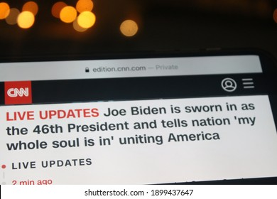 Moscow, Russia - 20 January 2021: CNN news with Joe Biden is sworn in as the 46th President and tells nation 'my whole soul is in' uniting America headlines on a smartphone screen.