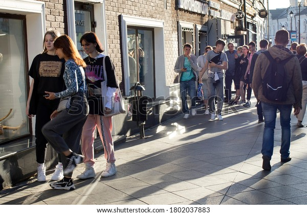 Moscow, Russia - 20.08.2020, teenagers and passers-by walk along the sidewalk in the center of Moscow