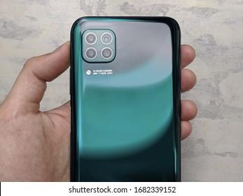 Moscow / Russia - 2020 March 20: Man holds Huawei P40 Lite (aka Nova 7i or Nova 6 SE)