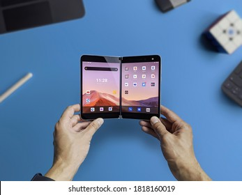 Moscow / Russia - 2020 September 17: Man holds Microsoft Surface Duo — first Android smartphone from Microsoft