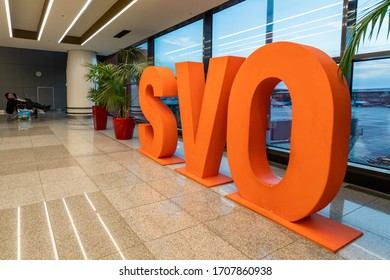 Moscow, Russia - 2020: Sheremetyevo International Airport, large orange letters SVO in the hall.