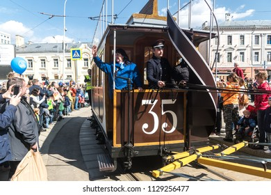 MOSCOW, RUSSIA - 21 april 2018: A horsecar with four horses in a harness takes part in a tram parade on Chistoprudny Boulevard in Moscow