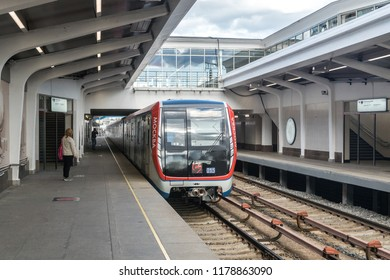 """MOSCOW, RUSSIA - 22 august 2018: New modern Moscow metro train """"Moscow"""" (model 81-765.2) arrives at the metro station Studencheskaya Filevskaya line (line 4)"""