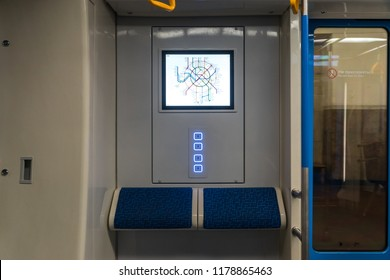 """MOSCOW, RUSSIA - 22 august 2018: Passengers traveling in cars with a new design of the modern train of the Moscow metro """"Moscow"""" (model 81-765.2)."""