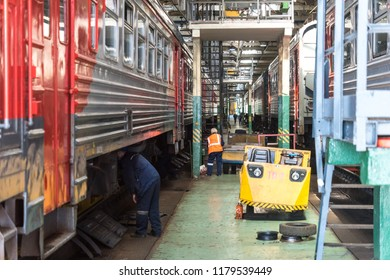 MOSCOW, RUSSIA - 24 august 2018: Workers in the depot inspect the rolling stock of commuter trains before leaving the line from the depot Kryukovo