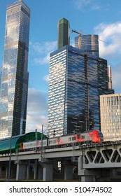 """Moscow, Russia - 24 September 2016:The station of the Moscow central ring of the """"Moscow City"""" on the background of skyscrapers of Moscow International Business Center, train departs from the station."""