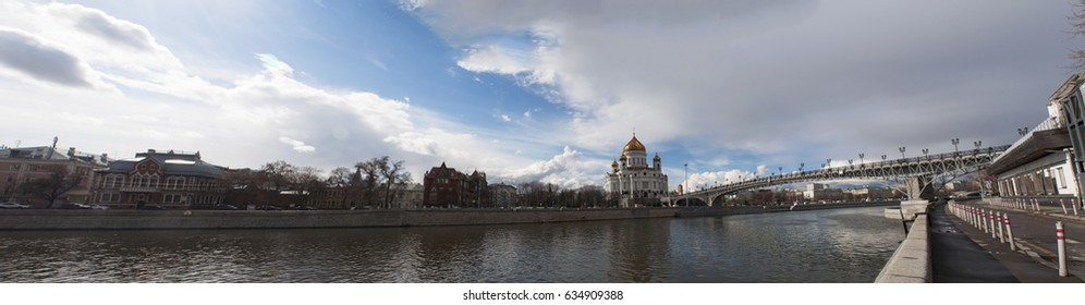 Moscow, Russia, 26/04/2017: panoramic view of the Cathedral of Christ the Saviour, the tallest Orthodox Christian church in the world, and Patriarch Bridge seen from the south bank of the Moskva River