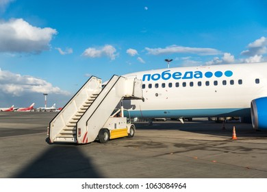 MOSCOW, RUSSIA - 28 march 2018: The ramp at the airport by the plane Boeing 737-800 of Pobeda airlines