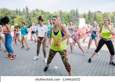 Moscow Russia 28.07.2018 EcoLifeFest energetic Zumba dance dancing people in the city park, fitness