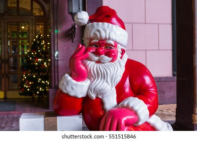 "MOSCOW, RUSSIA - 30 DECEMBER 2016: Plastic figure of Santa Claus in front of the restaurant ""Prague"" on the Arbat street"