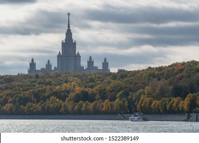 Moscow, Russia - 3d October: Autumn cityscape. View at Moscow State University towering over the autumn forest and Moscow river.