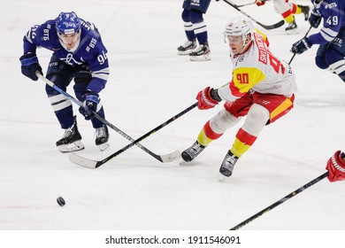 Moscow, Russia. 3rd February, 2021. KHL Regular Season ice hockey match: Dinamo Moscow Vs Jokerit Helsinki 5:1 - Moscow VTB Arena. #94 Andrei Mironov, #90 David Sklenicka