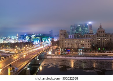 MOSCOW, RUSSIA - 4 JANUARY 2017: Night view to Borodinsky Bridge over the Moskva river, Evropeisky shopping mall and Moscow City international business center on background