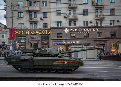 Moscow - Russia 4 May, 2015: Armata T-14 main battle tank unique, next generation heavy military vehicle and people on roadside for see the parade rehearsal on May 4, 2015 in Tverskaya street  Moscow.