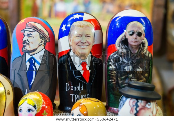 MOSCOW, RUSSIA - 5 JANUARY 2017: Russian traditional nested dolls. Dolls have a portrait of Vladimir Lenin, Vladimir Putin and Donald Trump.