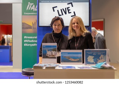 """MOSCOW, RUSSIA - 8 DECEMBER 2018: Stand of ENIT, Italian national touristic agency at """"Italy Week"""" exhibition, held in Moscow from 8 to 11 December 2018."""