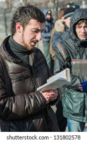 MOSCOW, RUSSIA - 8 MARCH: Dmitry Enteo, orthodox activist, reads Bible aloud on picket to free Pussy Riot members on March 8, 2013 in Moscow.