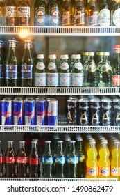 Moscow, Russia - 9 August, 2019: Various of soft drinks, waters, soda, milks and beers are sale on the refrigerator cooler shelf in a hypermarket