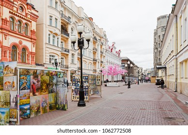 MOSCOW, RUSSIA - APRIL 03, 2018: Tourists and residents walking down the street old Arbat in Moscow in Russia in early spring.