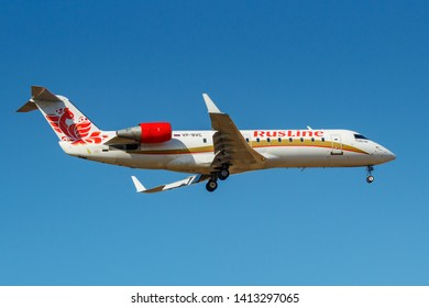 Moscow, Russia - April 03, 2019: Aircraft Bombardier CRJ-100ER (CL-600-2B19) VP-BVC of Rusline airline going to landing against blue sky at Vnukovo international airport in Moscow at sunny day