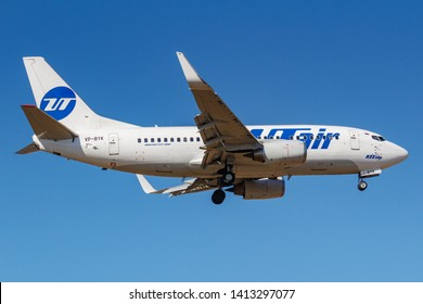 Moscow, Russia - April 03, 2019: Aircraft Boeing 737-524(WL) VP-BYK of UTair Aviation going to landing against blue sky at Vnukovo international airport in Moscow at sunny day