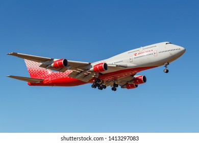 Moscow, Russia - April 03, 2019: Aircraft Boeing 747-446 EI-XLH of Rossiya - Russian Airlines going to landing against blue sky at Vnukovo international airport in Moscow at sunny day