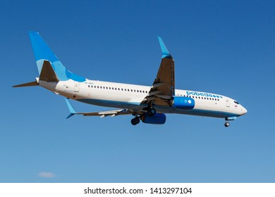 Moscow, Russia - April 03, 2019: Aircraft Boeing 737-8AL(WL) VP-BPX of Pobeda airline going to landing against blue sky at Vnukovo international airport in Moscow at sunny day