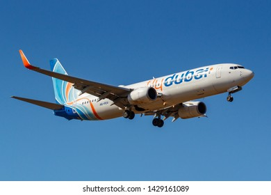Moscow, Russia - April 03, 2019: Aircraft Boeing 737-8KN(WL) A6-FEV of Flydubai airline going to landing against blue sky at Vnukovo international airport in Moscow at sunny day