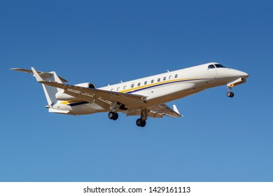 Moscow, Russia - April 03, 2019: Aircraft Embraer EMB-135BJ Legacy OE-LLG of MJet airline going to landing against blue sky at Vnukovo international airport in Moscow at sunny day