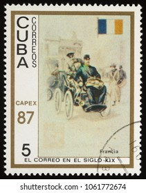 "Moscow, Russia - April 05, 2018: A stamp printed in Cuba shows old French Auto post, series ""International Stamp Exhibition Capex '87"", circa 1987"