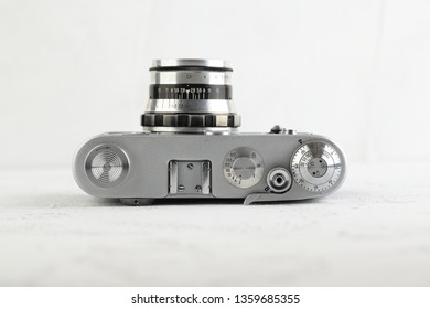 MOSCOW, RUSSIA, APRIL 05, 2019. The old Soviet 35 mm film rangefinder camera FED-3, released 1967 on white cement background.