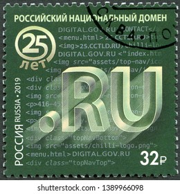 MOSCOW, RUSSIA - APRIL 05, 2019: A stamp printed in Russia shows National domain in Russia .RU, 2019