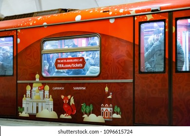 MOSCOW, RUSSIA - April 07, 2018: Metro train at the ring station of the Moscow subway with the symbols of the World Cup FIFA 2018 mundial. One of the sites is the Saransk city.  Info of tickets sale